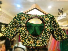 Beautiful bottle green color bridal designer blouse with floret lata design hand embroidery thread work.  call/watsapp +918179668098  23 July 2018