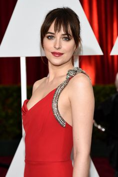 Dakota Johnson - On the red carpet, in piece-y bangs, a textured ponytail, and red lip stain, the actress was the picture of modern ease.