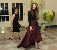 The singer Sara Bareilles (in red skirt), who performed at the dinner, with Jennifer Bareilles.