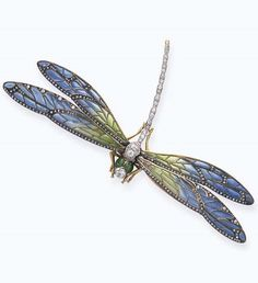 AN ANTIQUE ENAMEL AND DIAMOND BROOCH. Designed as a dragonfly, set en-tremblant, the body composed of a series of old European-cut diamonds, with green enamelled eyes, extending blue and green pliqué-a-jour enamelled wings, with rose-cut diamond detail, mounted in 18k gold and platinum, circa 1890, with French assay marks and maker's mark (indistinct) Numbered. #ArtNouveau #brooch