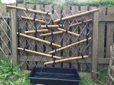 """Water wall made with bamboo guttering from the blog """"I'm a teacher get me outside here!"""""""