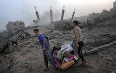 This photo shows Palestinians trying to save their belongings from their ruined homes.