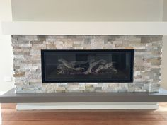 This installation was recently completed in Eltham, Vic. It iincludes a Regency GF 1500L gas log fire with stacked stone feature wall, plaster mantel shelf and Caesar stone floating hearth.