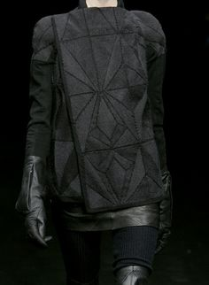 Geometric Fashion - black on black, structured look with leather, mixed fabrics & stitched geometric patterns; fashion details