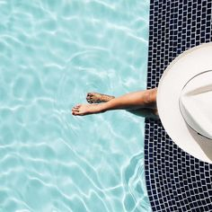 Saturdays are for lounging. (Preferably poolside.) Shop the panama hat via the link in our bio. cc: @ladulcivida #regram #sunnysomewhere