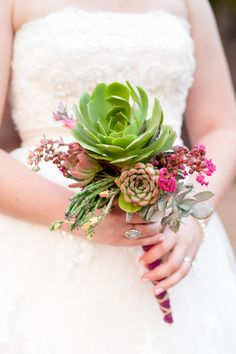 Colorful bridal bouquet with succulants. #weddings #weddingphotos