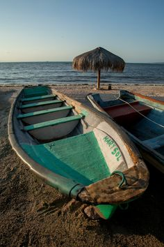 Boats along the #beach at the Malecon in La Paz, #Mexico #travel via @travelrinserept