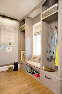 Mud room with magnetic wallboard and picture light above