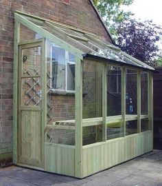 Neat Little Greenhouse! This would look nice off the side of the garden shed. #gardendesign