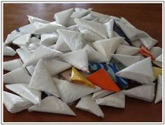 Grocery bag triangle/football fold - quick and gets rid of the bulk!  http://mousechirpy-polkadotpineapple.blogspot.com/2009/03/grandmothers-apron-carryall.html