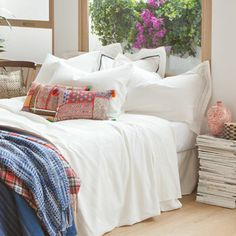 love the ethnic style cushions with crisp white bedlinen
