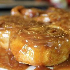 Quick Sticky Buns! These sweet treats have a surprise topping—thinly sliced bananas, along with chopped pecans and melted brown sugar. It's easy to create individual buns using a muffin tin and pre-sliced refrigerated biscuits.