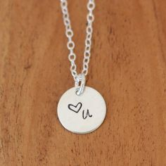 Remind someone you love them with this adorable silver charm necklace! #heartyou #lovenecklace