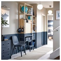 A hallway containing an IKEA IVAR storage unit with a foldable table furnished as a home office, with the table folded away. Ivar Regal, Painted Table Tops, Foldable Table, Ikea Family, Storage Spaces, Storage Units, Shelving, Living Spaces, New Homes