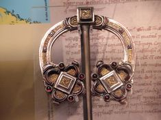 A chieftain's penannular brooch (worn by both men and women) from ancient Celtic societies until today. This one can be found in Glasgow's Kelvingrove Museum.