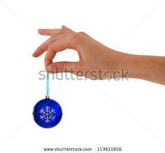 woman holding in hand Christmas toy - stock photo