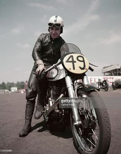 British world champion motorcyclist and racing driver John Surtees sits astride the 500cc Manx Norton during International Motorcycle races on 9th April 1955 at the Silverstone Circuit in Towcester, Great Britain.