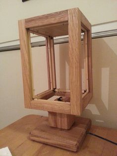 Beautiful oak wood lamp made by  Ashton Real Wood for my stained glass panels to fit into.