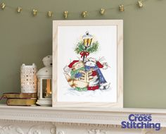 Adorable carol-singing cats - cross stitch pattern, by Margaret Sherry, in issue 209 of The World of Cross Stitching magazine