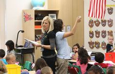 "In their combined classroom, kindergarten teachers Ann Renee Evans, left, and Cassandra Hinson have each other's backs. Together they teach 35 students in their shared classroom, managing the large group seamlessly and without either one vying to be ""the leader."""