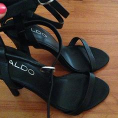 Black strappy heels by ALDO Black with silver accents. Purchased at Nordstrom rack for almost $70 including tax. Never worn. ALDO Shoes Heels