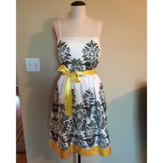 Spaghetti Strap Summer Dress w/ Sash sz 16 Spaghetti Strap (Black & Yellow) Summer Dress w/ Sash sz 16▪️It has a full skirt. That is the sash that came with the dress even though the band at the bottom and sash don't identically match. It also comes with built in bra cups/padding. Jessica Howard Dresses