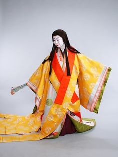 Woman dressed in junihitoe.