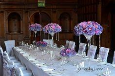 Beautiful purple wedding flowers by Fiori by Lynne for Rhinefield House reception.