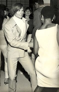 Rudolf Nureyev doing the Twist. First sign of a smile I have ever seen in a photo of Rudolf Nureyev.