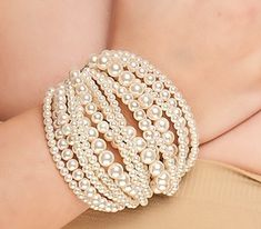 A fresh take on a classic, cuff-style bracelet!  I love the different sizes as it draws the eye into the piece.