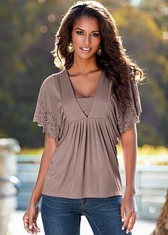 Taupe (TP) Laser Cut Detail Top $36 Find the essence of your femininity in pretty pleats and eyelets. ·  	Rayon/spandex   ·  	Imported  ·  	Style #Y34501