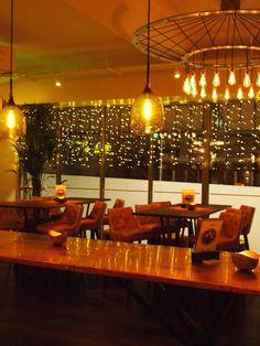 Vintage LED filament light bulbs inside The Alchemist bar. See the full LED range at Bright Goods.