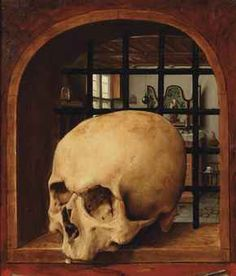 Southern Netherlandish School, c. 1530 A Vanitas with a skull in a niche, an interior in the background