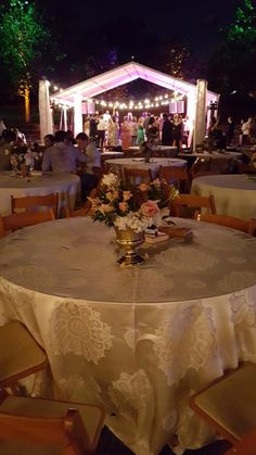 This elegant golden linen has a matching centerpiece for this wedding reception.