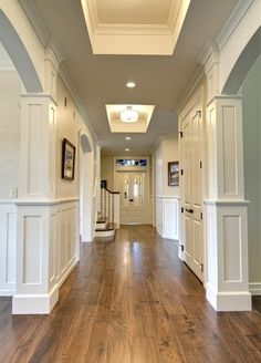 Paint for the interior.Hallway with wooden floors and wainscotting