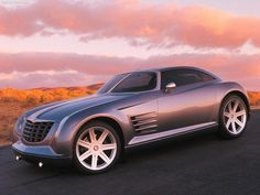 Chrysler Crossfire Concept - I know it's a Chrysler, but if they had actually made this concept into a car, I'd consider getting one. It's an art deco sports car! Chrysler Crossfire, Motor Works, Auto Glass, Car Images, Car Manufacturers, Hot Cars, Maserati, Custom Cars, Concept Cars
