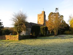 View of Huntsham's All Saint's Church from Huntsham Court's driveway on a frosty autumn morning.