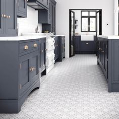 kitchen flooring Although a classic grey ceramic tile this x matt design fits comfortably with the current trends for geometric patterns. Mr Jones from the Heritage Collection is a square floor tile initially introduced in 1984 by Laura Ashley herself. Kitchen Floor Tile Patterns, Grey Floor Tiles, Ceramic Floor Tiles, Floor Patterns, Grey Flooring, Geometric Patterns, Kitchen Flooring, Kitchen With Tile Floor, Ceramic Flooring