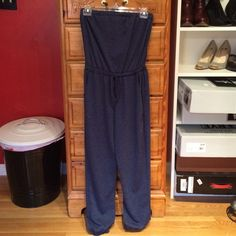 LOVE FIRE Sweat Pant Material Jumpsuit Size XS This sweat suit material jumpsuit is super soft & comfortable, no damage, worn a handful of times, has pockets and an elastic top with a draw string waist. This jumpsuit is a dark blue color. Please let's know if you have any questions! TRADE Love Fire Other