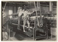 """""""Bibb Mill No. 1, Macon, Ga. Many youngsters here. Some boys and girls were so small they had to climb up on to the spinning frame to mend broken threads and to put back the empty bobbins"""""""