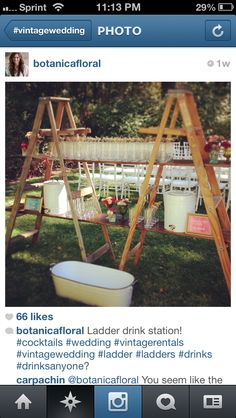 Ladder drink station - wrap with caution tape / banners - would give nice height for display decor on top too