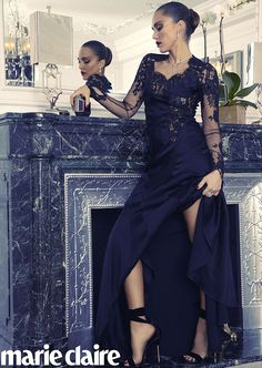 Jessica Alba strikes a pose by a grand fireplace and large mirror for Marie Claire