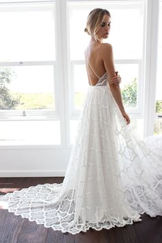 The Harriet gown from our Blanc Collection is perfectly timeless and understated. Designed for the effortlessly enchanting Grace girl.
