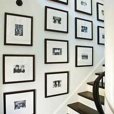 Phoebe Howard - entrances/foyers - black, white, photos, black, gallery, frames, staircase, art gallery, glossy, black, staircase railing, photo walls, photo wall collage, photo wall ideas, family photo walls,