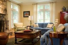Living room colors: blue couch.  Like the shade of yellow.