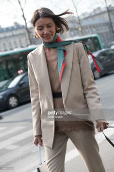 Fashion director for Vogue Ukraine Julie Pelipas wears a Céline bag, earrings and suit day 3 of Paris Womens Fashion Week Spring/Summer 2018, on February 28, 2018 in London, England.