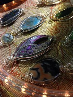 Beautiful wire wrapped stones by Rosi M.