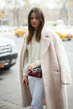 Keeping warm in pale pink coat combined with off-white angora sweater and white jeans.