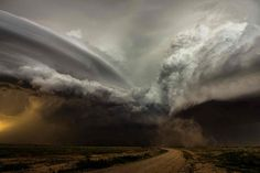"""Clash of the storms, New Mexico by Camelia Czuchnick. """"A clash between two storm cells in New Mexico, US, each with its own rotating updraft. The curved striations of the oldest noticeable against the new bubbling convection of the newer. It was a fantastic sight to watch and it's the rarity of such scenes that keep drawing me back to the US Plains each year."""""""
