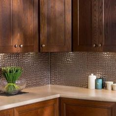 Update the look of your kitchen or bathroom with this Fasade Terrain Brushed Nickel Vinyl Decorative Wall Tile Backsplash.